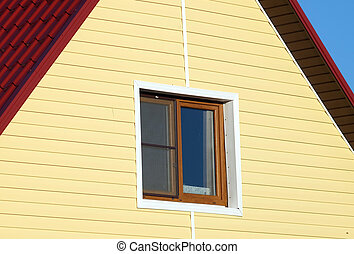 Wall covered with yellow siding