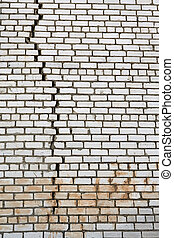 wall crack - wall of white silicate bricks with a large...