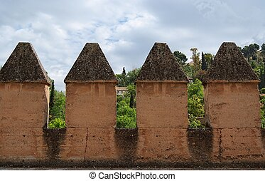 Wall crenellations in medieval castle in Spain