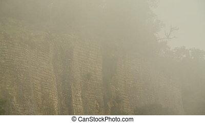 Wall Enshrouded by Mist - Steady, medium wide shot of a...