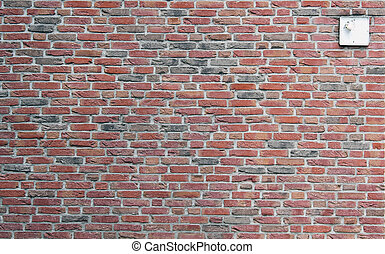 wall from a red clay brick with the broken lamp