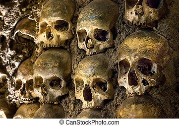 Wall full of skulls and bones in the bone chapel in Evora, Portugal