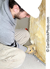 Wall insulation being installed by builder
