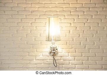 Wall lamp on brick wall