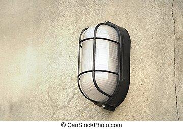 Wall lamp on cement floor
