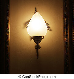 Wall lamp with a shade on the background