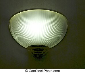 WALL LIGHT - A wall light enclosed in fluted transluscent...