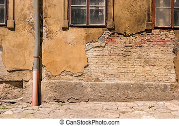 Wall of a damaged building.