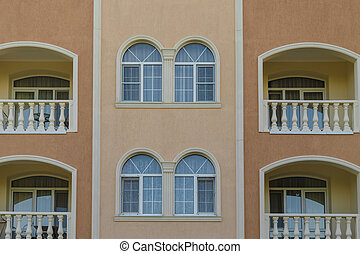 Wall of a house with windows in a classic design.