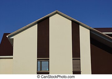 wall of a private brown house with windows