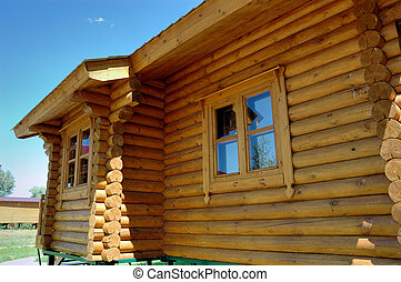 Wall of a wooden house with windows.