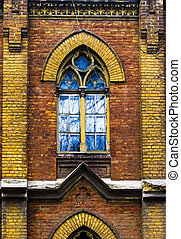 Wall of an old brick building with a window, architecture
