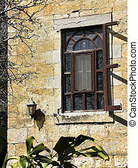 wall of an old house with a window