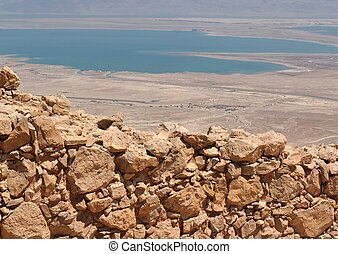 Wall of ancient fortress in the desert near the Dead Sea