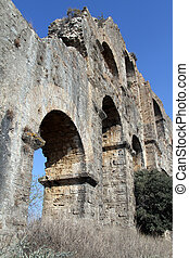 Wall of aquaduct - Wall of old ruined aquaduct near...