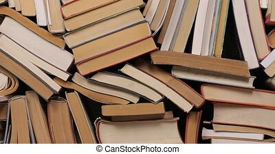 Many books in a pile, camera zooming in