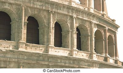 Wall of Colosseum. Ancient building with arches.