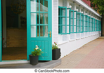 Wall of house with set of windows