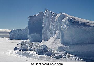 wall of icebergs frozen in the ice of Antarctica