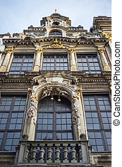 Wall of medieval gothic city hall in Grand Place in Brussels...