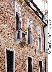 wall of medieval palazzo on street contra porti