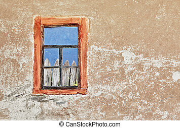 Wall of old ukrainian house with a window
