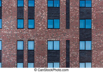 Wall of red brick with windows. Pattern