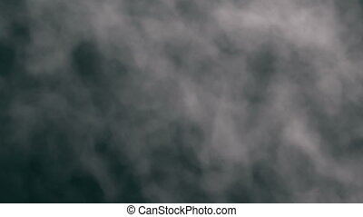 Looping animation of an undulating grey smoke mass completely covering the frame and moving upwards.
