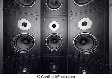 Wall of speakers. - Black, wooden loudspeakers in a stack.