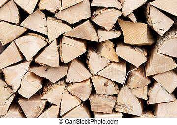 Wall of stacked firewood logs as background