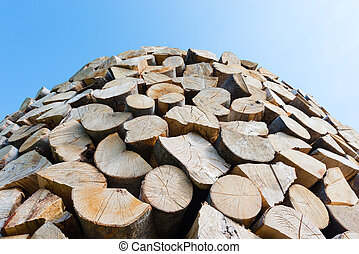 Wall of stacked wood logs as background