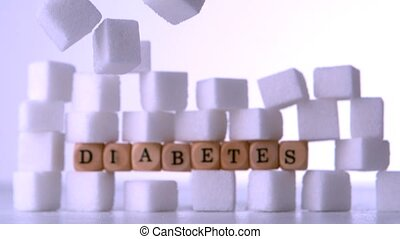 Wall of sugar cubes with dice spelling out diabetes on white...