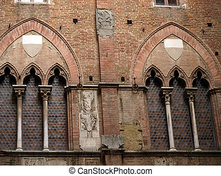 Wall of the courtyard in Palazzo Pubblico. Siena, Tuscany