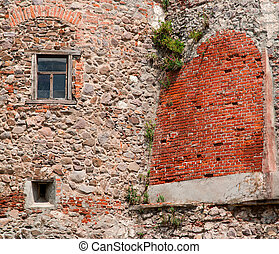 Wall of the old house, with a window