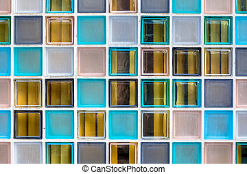 Wall of transparant glass boxes serving as colorful window...