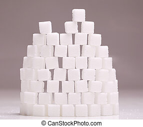 Wall of white sugar cubes stacked up