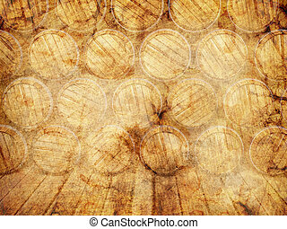wall of wooden barrels on a grunge background