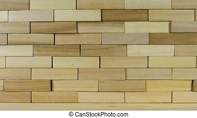 Wall of wooden bricks breaks from the impact, slow motion