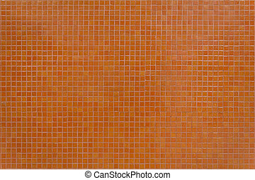 Wall orange tiles with little mosaic squares.