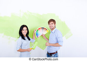 Wall Paint - young couple smile choose palette color pantone...