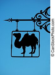 Wall sign with camel
