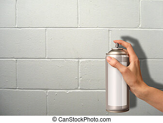 wall spraying - female hand using a spray cannister on a...