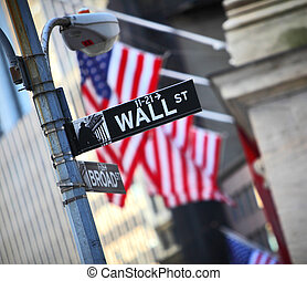 Wall Street sign and flag background in New York City