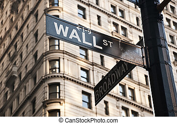 Wall Street sign - Street sign at the corner between Wall...