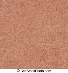 Terracotta color paint on a textured wall in Italy. Detail closeup ideal for use as a template or background