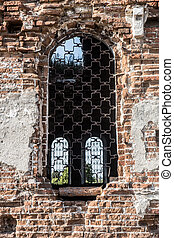 wall with a window of an old destroyed church