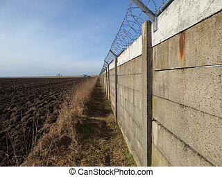 Wall with barbed wire