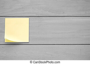 Wall with blank sticky note