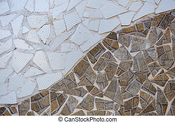 wall with cut out pieces of tile