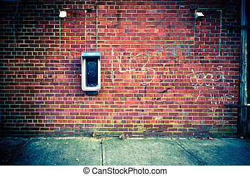 Backdrop image of a brick wall with a payphone